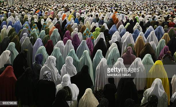Muslim women pray outside Mecca's Grand Mosque on November 15 2009 Some 25 million Muslims from more than 160 countries converge annually on the...
