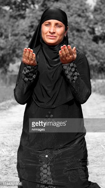 muslim women praying to god - namaz stock pictures, royalty-free photos & images