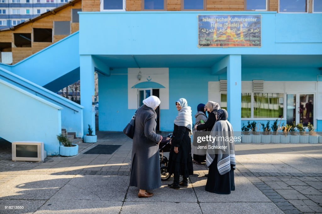 Muslim women stand in front of the Muslim cultural center and mosque following a recent attack just before the beginning of the visit of Aydan Ozoguz (not pictured), German Federal Commissioner for Immigration, Refugees and Integration on February 14, 2018 in Halle an der Saale, Germany. Shots possibly fired with an air gun from a nearby building injured a mosque member earlier this month, only a week after a similar incident. The center has been the target of attacks since 2015 in a city that struggles with right-wing extremism, which has become more virulent since over a million mostly Muslim refugees and migrants came to Germany in 2015-2016.