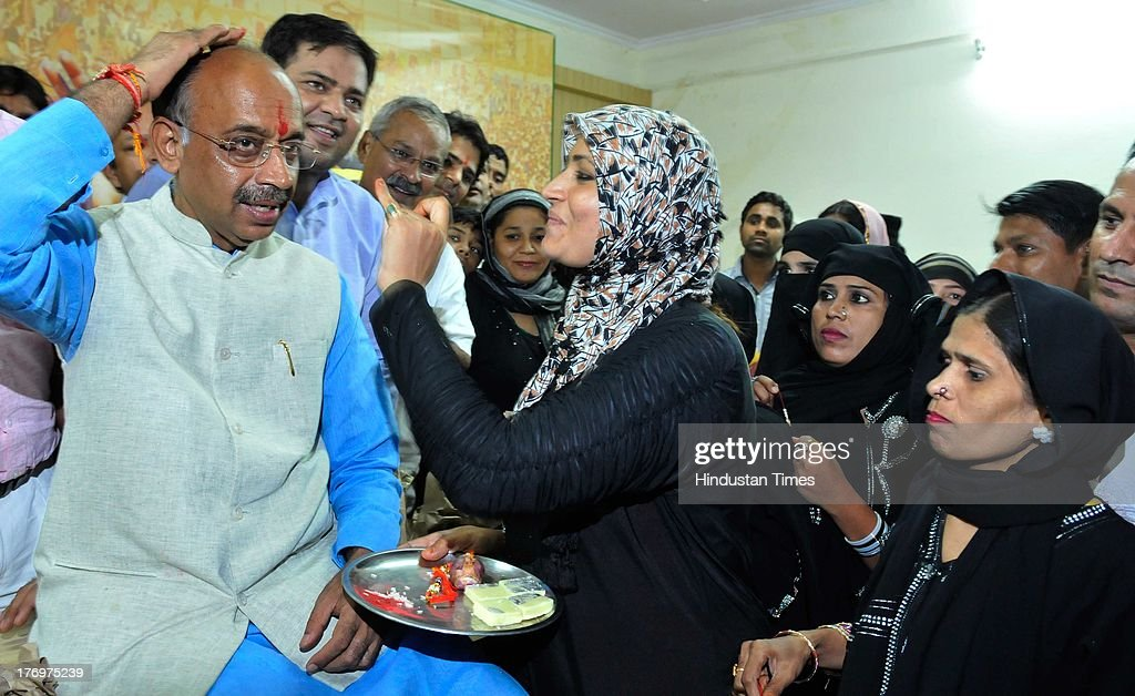 Muslim women tying rakhi made with onion to Delhi BJP President Vijay Goel on August 20, 2013 in New Delhi, India. Raksha Bandhan, the festival of love between brothers and sisters, is being celebrated across the country today with full enthusiasm.