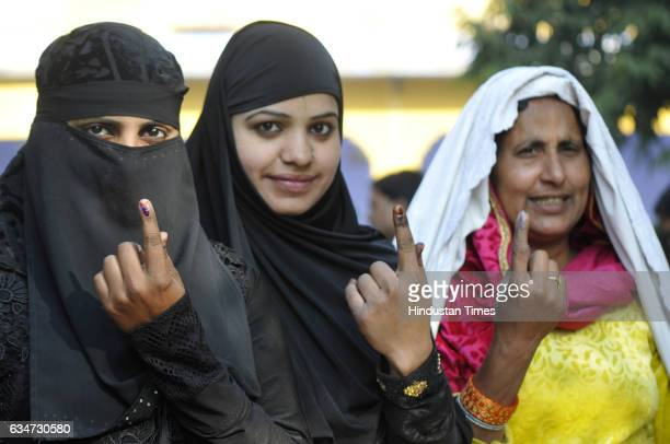 Muslim women voters cast their vote at Janta Inter College in Jewar constituency on February 11 2017 in Greater Noida India Uttar Pradesh registered...