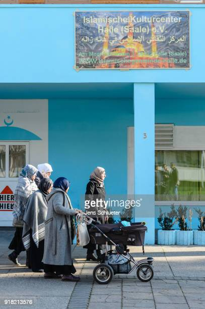 Muslim women walk along the Muslim cultural center and mosque following a recent attack just before the beginning of the visit of Aydan Ozoguz German...