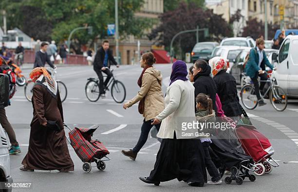 Muslim women wearing headscarves walk in the immigrantheavy district of Kreuzberg on September 21 2010 in Berlin Germany German politicians are...