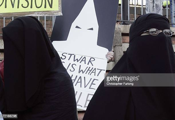 Muslim women wearing niqab and burqa veils protest outside Bangor Street Community centre where Leader of the House of Commons Jack Straw is holding...