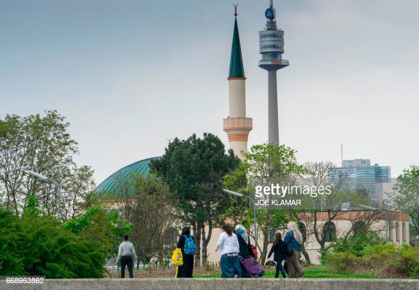 Muslim women with children walk towards a mosque at the Islam Centre of Vienna on April 14 2017 in Vienna Austria A debate is raging in Austria after...