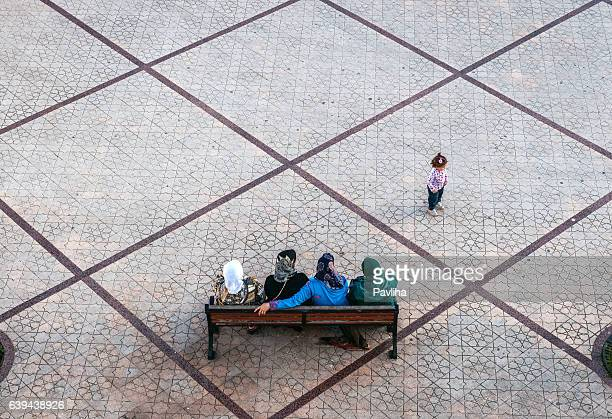 Muslim womens sitting, girl playing ,Chefchaouen,Morocco,North Africa