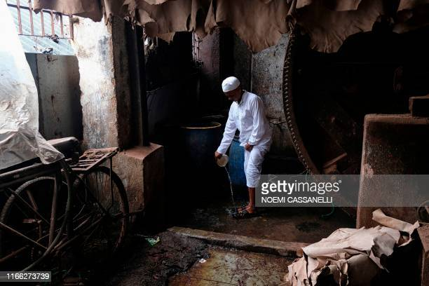 Muslim worker washes his feet in a leather workshop in the lowincome neighborhood of Dharavi in Mumbai on September 6 2019