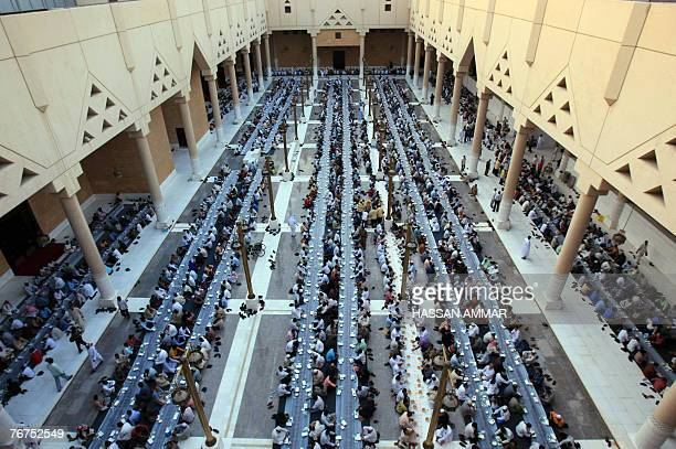Muslim workers break their fast on the first Friday of Ramadan at the Imam Turki bin Abdullah mosque in Riyadh 14 September 2007 The world's 12...