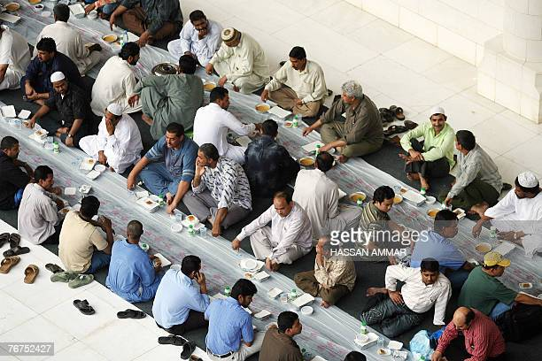 Muslim workers wait to break their fast on the first Friday of Ramadan at the Imam Turki bin Abdullah mosque in Riyadh 14 September 2007 The world's...