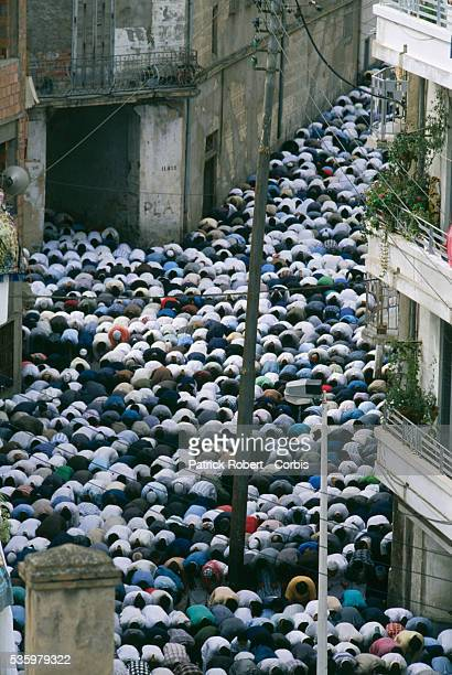 Muslim worshipers pray in the streets of Algiers near a mosque after riots broke out instigated by rising food prices in a country with an...
