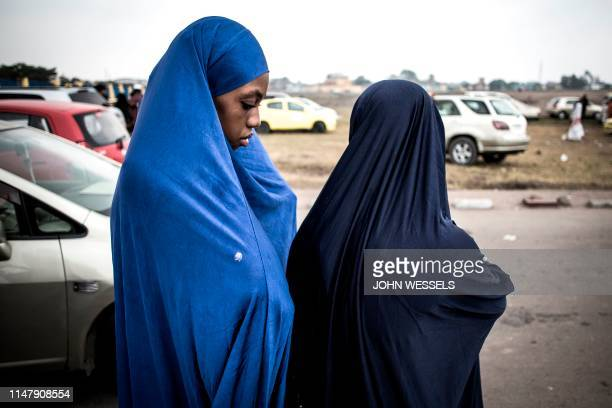 Muslim worshipper are seen after a mass prayer to celebrate Eid al-Fitr on June 4, 2019 at the Stade des Martyrs in Kinshasa. - Muslims worldwide...
