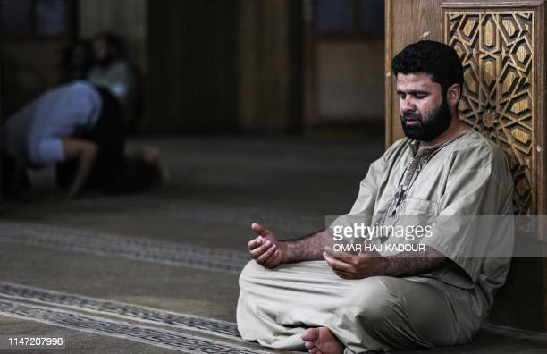A Muslim worshipper prays at a mosque in Maaret alNuman in Syria's northwestern Idlib province early on June 1 on the occasion of Lailat alQadr which...