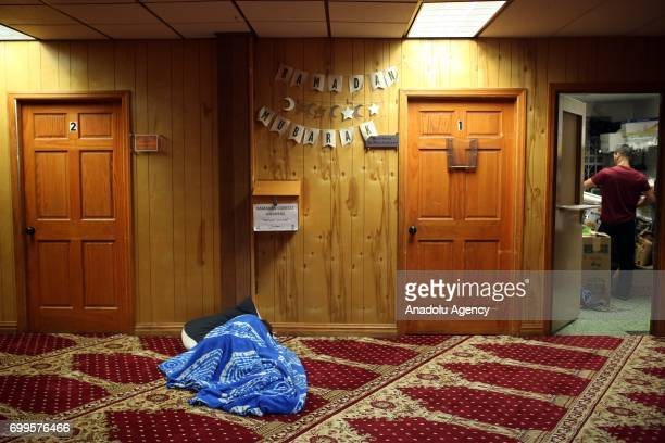 Muslim worshipper sleeps as an act of Itikaf after the Sahur at the Mosque on Laylat alQadr the night when the first verses of the Quran were...