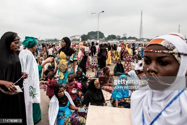 Muslim worshippers are seen after of a mass prayer to celebrate Eid al-Fitr on June 4, 2019 at the Stade des Martyrs in Kinshasa. - Muslims worldwide...