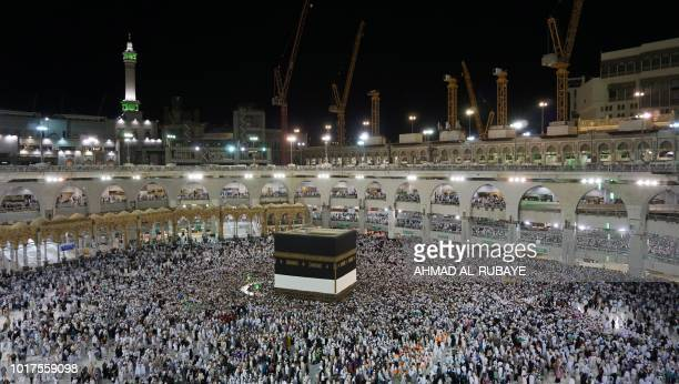 Muslim worshippers circle around the Kaaba Islam's holiest shrine at the Grand Mosque in Saudi Arabia's holy city of Mecca on August 15 prior to the...