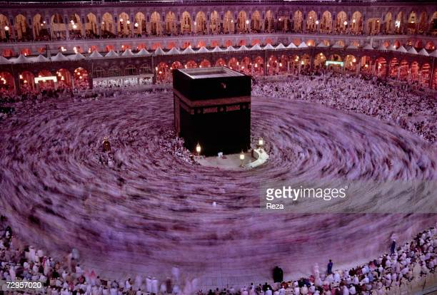 Muslim worshippers circle the Kaaba Islam's most sacred sanctuary and pilgrimage shrine within the Masjid AlHaram mosque on the eve of Eid ulFitr day...