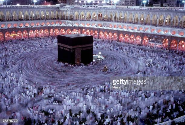Muslim worshippers circle the Kaaba Islam's most sacred sanctuary and pilgrimage shrine within the Masjid AlHaram mosque on December 2002 in Mecca...