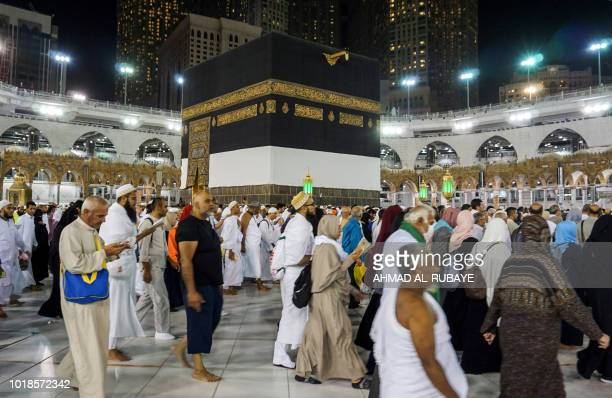Muslim worshippers circumambulate around the Kaaba Islam's holiest shrine at the Grand Mosque in Saudi Arabia's holy city of Mecca on August 17 2018...