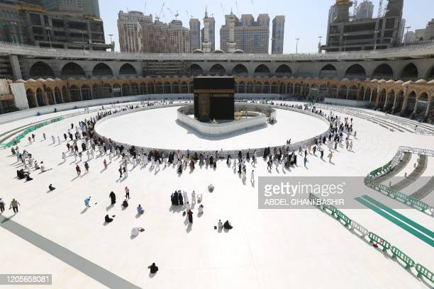 Muslim worshippers circumambulate the sacred Kaaba in Mecca's Grand Mosque Islam's holiest site on March 7 2020 Saudi Arabia reopened today the area...