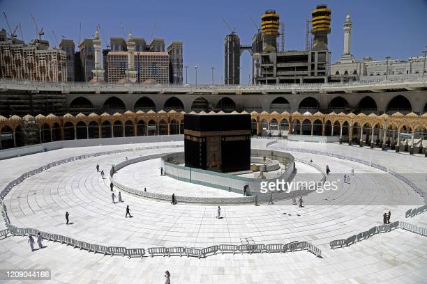 Muslim worshippers circumambulate the sacred Kaaba in Mecca's Grand Mosque, Islam's holiest site, on April 3, 2020. - Saudi Arabia on April 2...