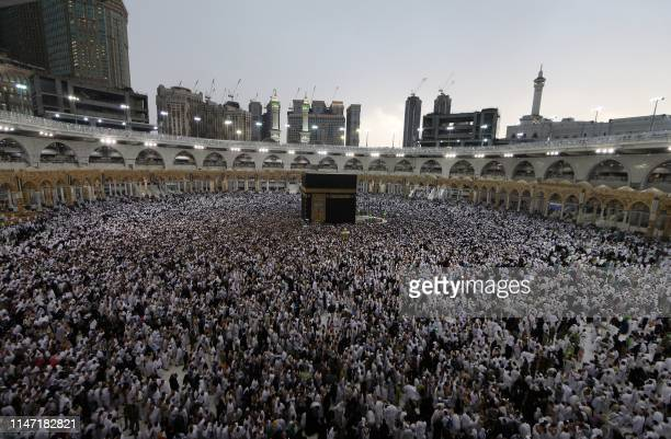 Muslim worshippers gather around the Kaaba Islam's holiest shrine at the Grand Mosque in the Saudi city of Mecca during the fasting month of Ramadan...