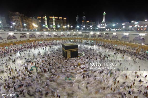 TOPSHOT Muslim worshippers gather at the Grand Mosque in Islam's holiest city of Mecca on June 14 2018 as Muslims perform the Umrah or lesser...