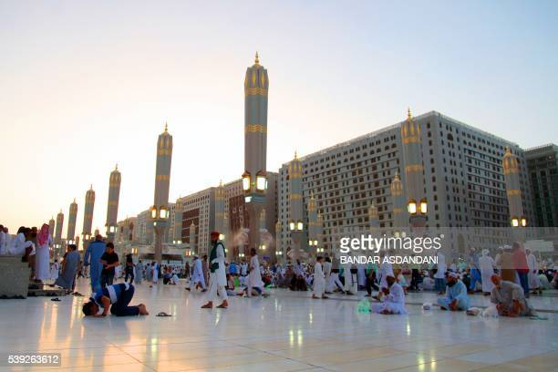 Muslim worshippers gather at the Prophet Mohammed Mosque during the Muslim holy fasting month of Ramadan on June 10 2016 in the Saudi holy city of...