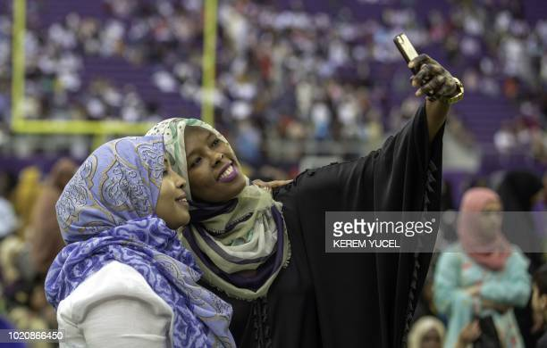 Muslim worshippers gather at the US Bank Stadium for Eid al-Adha celebrations August 21, 2018 in Mnneapolis, Minnesota. - US Bank Stadium is hosting...