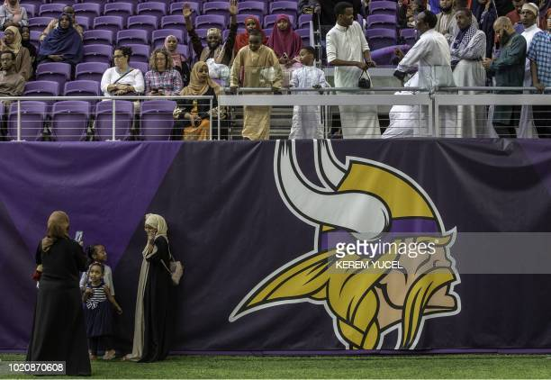 Muslim worshippers gather at the US Bank Stadium for Eid alAdha celebrations August 21 2018 in Mnneapolis Minnesota The US Bank Stadium home of the...