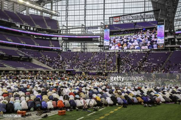 Muslim worshippers kneel in prayer at the US Bank Stadium during celebrations for Eid alAdha on August 21 2018 in Minneapolis Minnesota The US Bank...