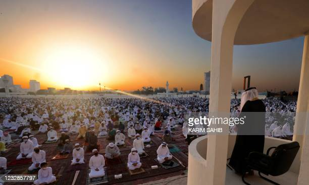 Muslim worshippers listen to the Eid al-Fitr morning prayer sermon at Dubai's Eid Musalla in the Gulf emirate's old port area on May 13 as Muslims...
