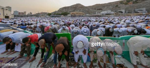 Muslim worshippers perform Eid al-Fitr prayers at the Grand Mosque in the Saudi holy city of Mecca on June 4, 2019. - Muslims worldwide celebrate Eid...