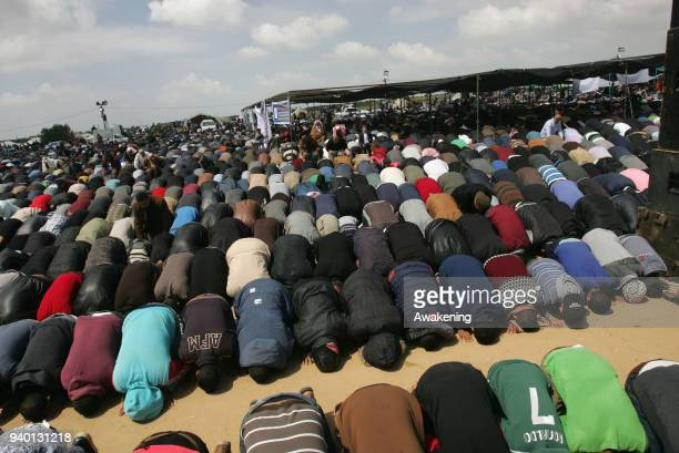 Muslim worshippers perform Friday noon prayers during a tent city protest near the border with Israel east of Gaza City to commemorate Land Day on...
