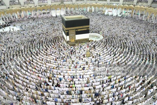 TOPSHOT Muslim worshippers perform prayers around the Kaaba Islam's holiest shrine at the Grand Mosque in Saudi Arabia's holy city of Mecca on August...