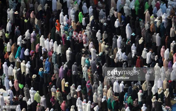 Muslim worshippers perform prayers around the Kaaba Islam's holiest shrine at the Grand Mosque in Saudi Arabia's holy city of Mecca on August 28...