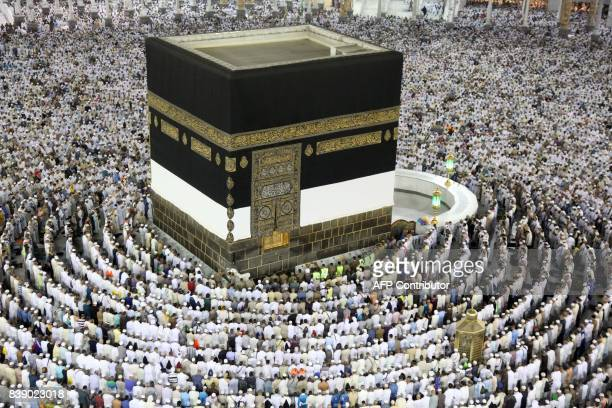 Muslim worshippers perform the evening prayers at the Kaaba Islam's holiest shrine at the Grand Mosque in Saudi Arabia's holy city of Mecca on August...