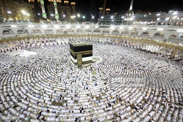 TOPSHOT Muslim worshippers perform the evening prayers at the Kaaba Islam's holiest shrine at the Grand Mosque in Saudi Arabia's holy city of Mecca...