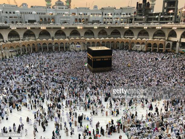 Muslim worshippers pray and circumambulate around the Kaaba Islam's holiest shrine at the Grand Mosque in Saudi Arabia's holy city of Mecca on August...