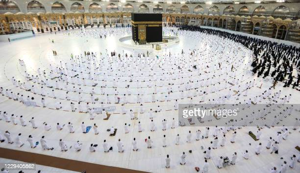 Muslim worshippers pray around the Kaaba in the Grand Mosque complex, Islam's holiest shrine, in Saudi Arabia's holy city of Mecca on November 1 as...