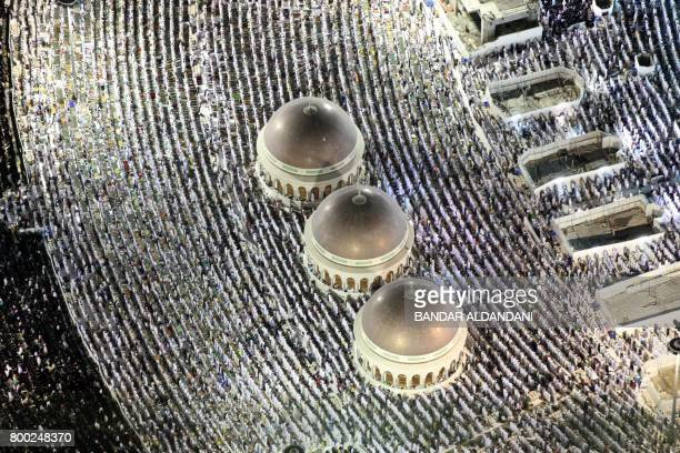 Muslim worshippers pray at the Kaaba Islam's holiest shrine at the Grand Mosque in Saudi Arabia's holy city of Mecca on June 23 during the last...