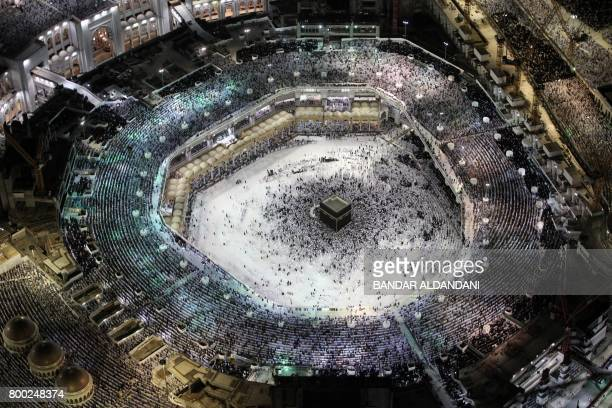 TOPSHOT Muslim worshippers pray at the Kaaba Islam's holiest shrine at the Grand Mosque in Saudi Arabia's holy city of Mecca on June 23 during the...