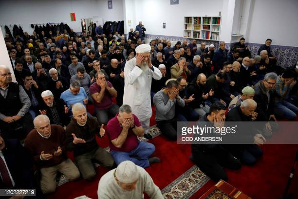 Muslim worshippers pray during the Friday prayer at the Ditib Mosque in Hanau near Frankfurt am Main western Germany on February 21 2020 Following a...