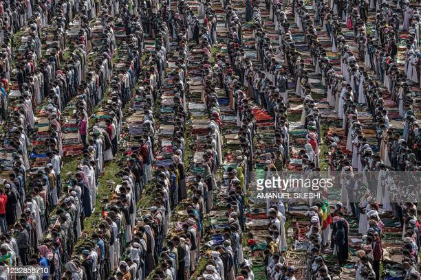 Muslim worshippers pray during the the Eid al-Fitr morning prayer sermon at a soccer stadium in Addis Ababa, Ethiopia, on May 13, 2021 as Muslims...
