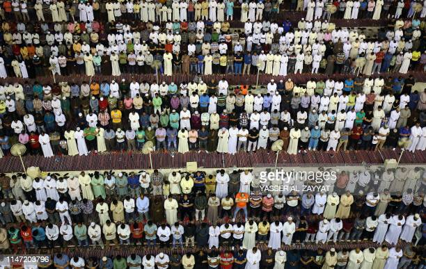 Muslim worshippers pray early on June 1 2019 at Kuwait City's Grand Mosque on the occasion of Lailat alQadr which marks the night in the fasting...