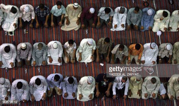 Muslim worshippers pray in Kuwait City's Grand Mosque just before dawn on September 17 2009 during Lailat alQadr prayers which commemorate the...