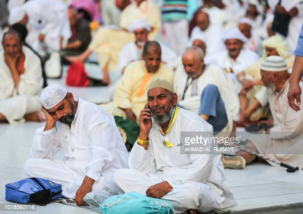 Muslim worshippers sit around the Kaaba Islam's holiest shrine at the Grand Mosque in Saudi Arabia's holy city of Mecca on August 17 2018 prior to...