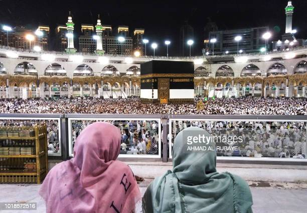 TOPSHOT Muslim worshippers watch as others circumambulate around the Kaaba Islam's holiest shrine at the Grand Mosque in Saudi Arabia's holy city of...