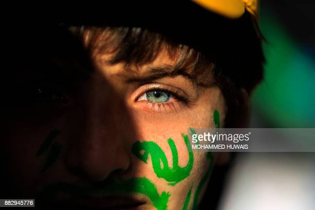 Muslim Yemeni boy with the world 'Allah' in Arabic painted on his face attends a rally in the capital Sanaa on the occasion of the Prophet Mohammed's...