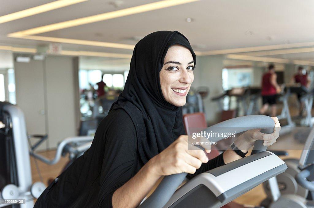 Muslim Young Woman Exercising : Stock Photo