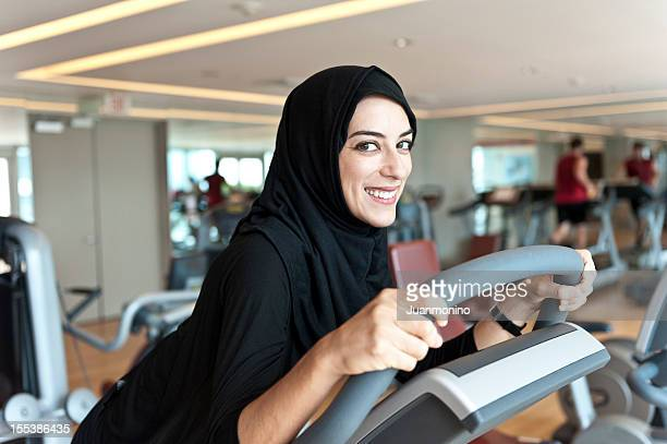 muslim young woman exercising - iranian woman stock photos and pictures